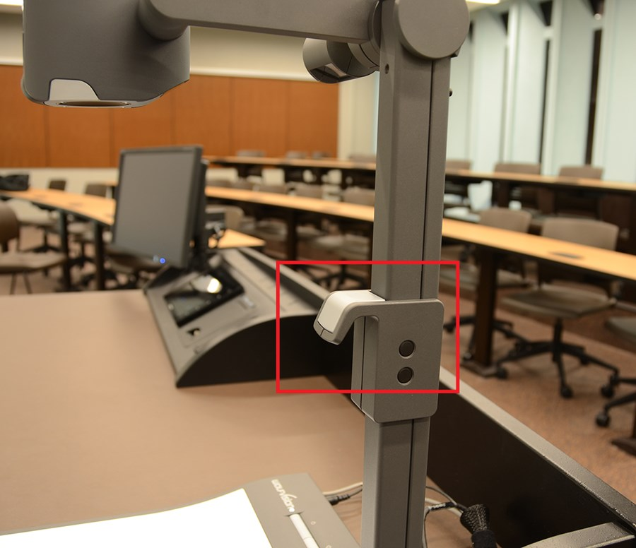 highlighting the document camera handle jutting out the front of the stand
