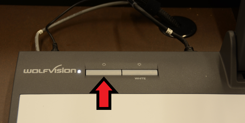 identifying projector power button at the top left of the device